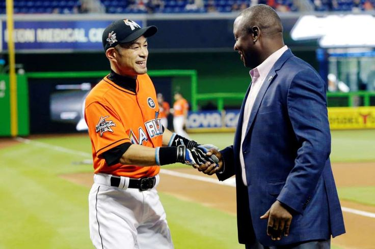 #3000:    Miami Marlins' Ichiro Suzuki, left, shakes hands with Michael Hill, president of baseball operations, during a pregame ceremony honoring Ichiro's 3,000th career hit before a baseball game against the Pittsburgh Pirates, on April 30, in Miami.