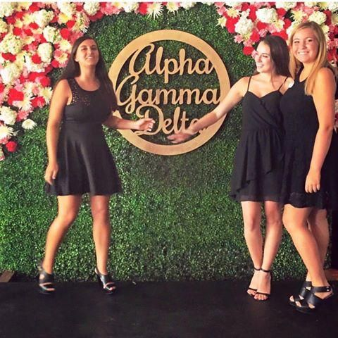 Flower Wall for Alpha Gamma Delta Pref Round at University of Georgia, Athens | Boxwood Wall Rental by Colonial House of Flowers