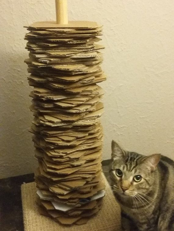 This cat scratch tower is made of 100% recycled corrugated cardboard. The tower is approximately 2 to 2 1/2 tall, the wood base is 12x12.   10% of all sales go to local animal shelters in Florida.