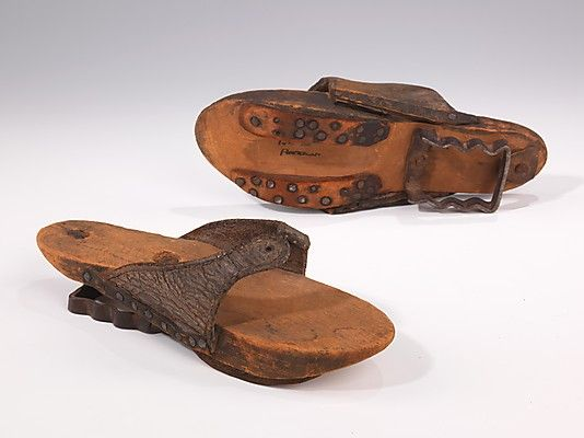 Overshoes (Pattens) late 18th C. American: Walking on rough unpaved or cobbled streets was perilous business in the thin silk-covered shoes of the 18th and early 19th centuries. This pair of overshoes is a rare and interesting combination of the two styles worn at the time, the clog and the patten.