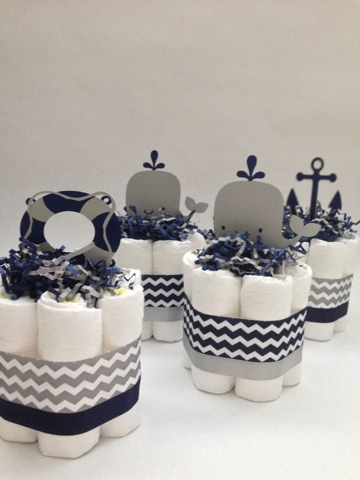 FOUR Navy and Grey Nautical Mini Diaper Cakes, Baby Shower Decoration, New Baby Gift, Nautical Baby Shower, Nautical Diaper Cake by MrsHeckelDiaperCakes on Etsy https://www.etsy.com/listing/248014693/four-navy-and-grey-nautical-mini-diaper