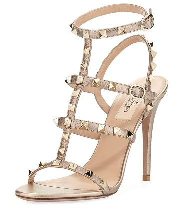"""Rockstud Metallic Leather 105mm Sandal by Valentino. Valentino Garavani metallic leather sandal with signature Rockstud trim. 4.1"""" (105mm) covered heel. Strappy caged upper. Two adjustable buckle straps. Leather lining. Smooth outsole. Made in Italy. #valentino #nudeshoes #sandals"""