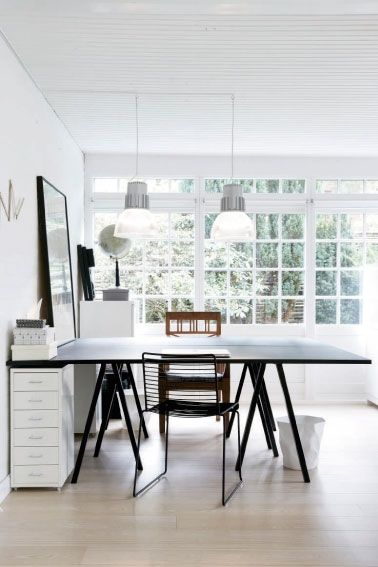 two-sided desk + white + leaning art work