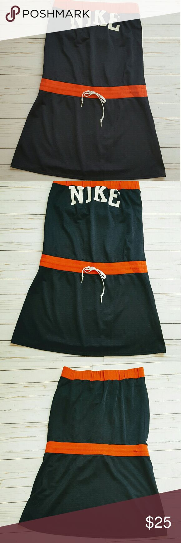 Nike Tennis dress Navy and Orange  Sz Lg Nike Tennis dress Navy and Orange Sz Lg with built-in bra, has adjustable pull ties at the waist and top. In great pre owned condition no trades please reasonable offers. Thanks Nike Dresses Mini