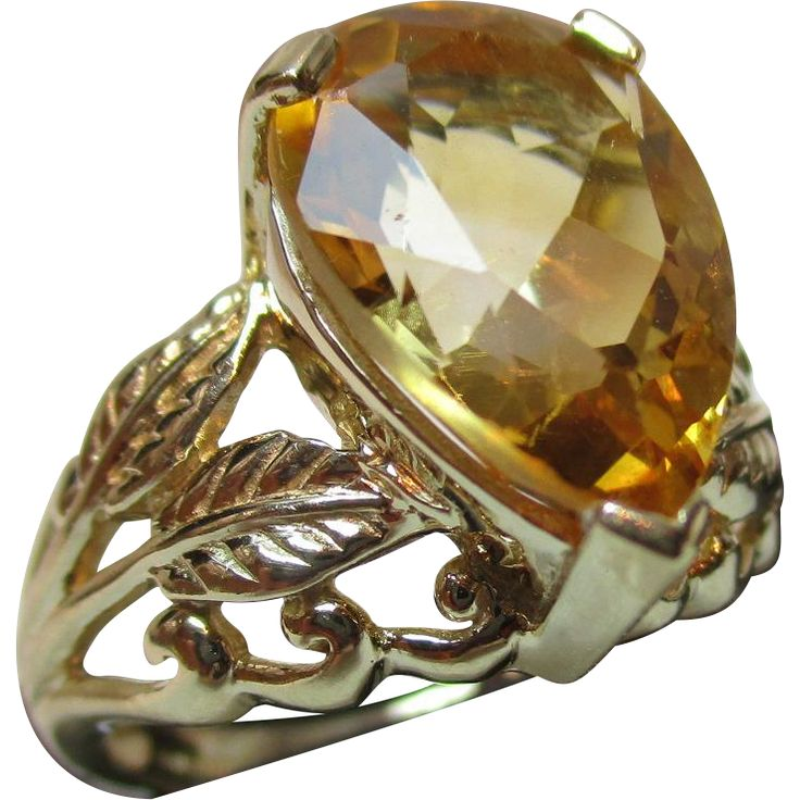 This is a delightful and vibrant 9ct solid gold citrine gemstone ring. The gemstone is claw-set into the ring, tear-drop shaped and of size 15.0mm x