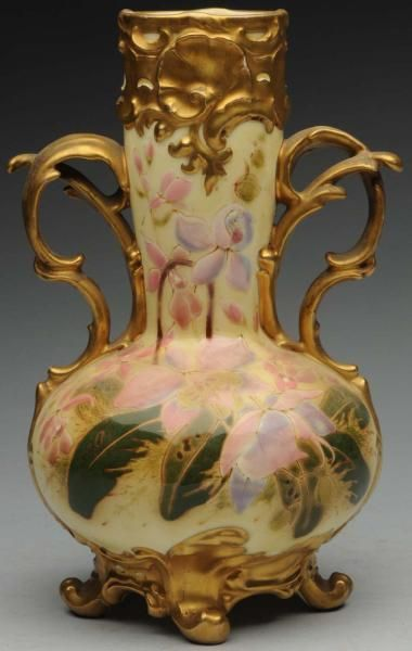 "Zsolnay Vase with Two Curved Gold Handles. 9 - 1/2"" T. Decorated with enameled floral and leaf designs with gold at top and bottom. (Near Mint). 13/L390U"
