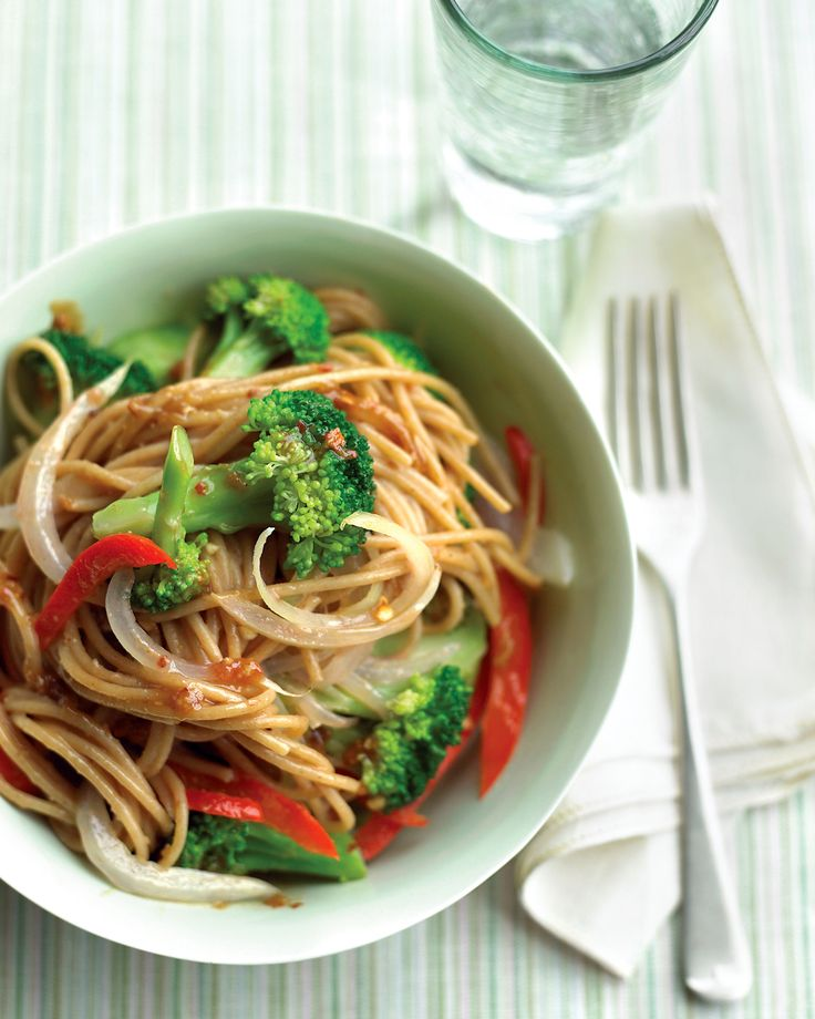 Lighter Sesame Noodles | Martha Stewart Living - Whole-wheat spaghetti complements the zesty sauce while adding fiber. A little less peanut butter plus a lot more vegetables make this a no-guilt meal.