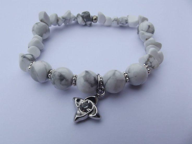 White howlit bracelet with a charm
