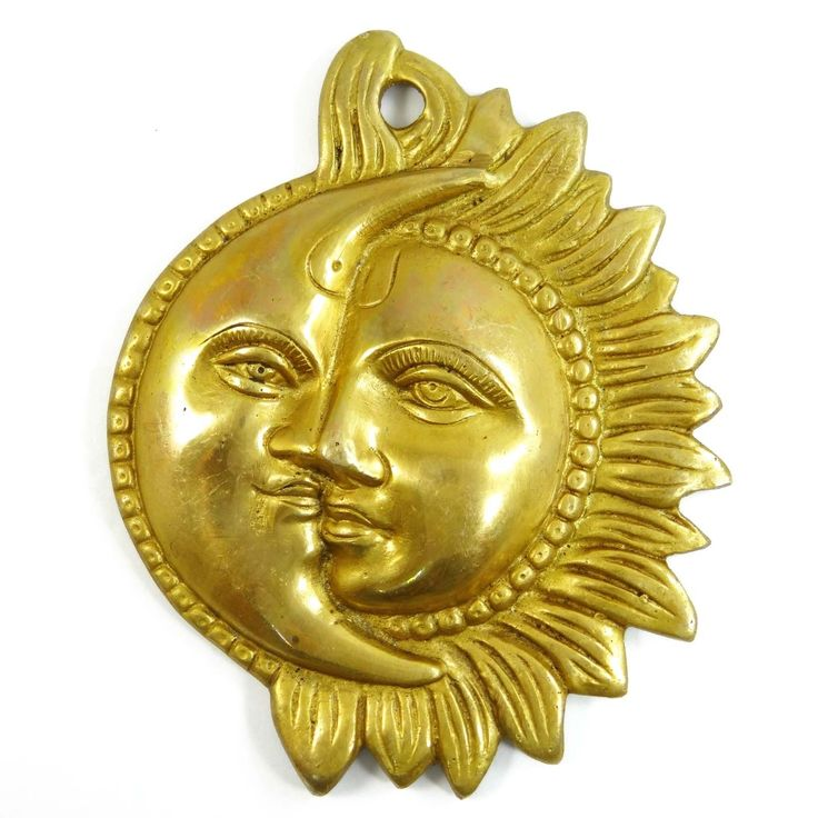 Give that ethnic look to your home with brass wall hanging is sun and moon face design, #brassstatue  #sunandmoon #walldecor