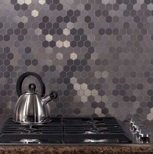 Honeycomb. A stainless backsplash combines industrial materials with an organic shape. Via Backsplash Ideas
