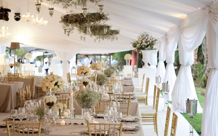 Wedding celebration in Victoria Falls on the banks of the Zambezi River - by Wedding Concepts #destination #wedding #zimbabwe #victoriafalls #gold #glamour #cream #draping #lighting #marquee #weddingconcepts