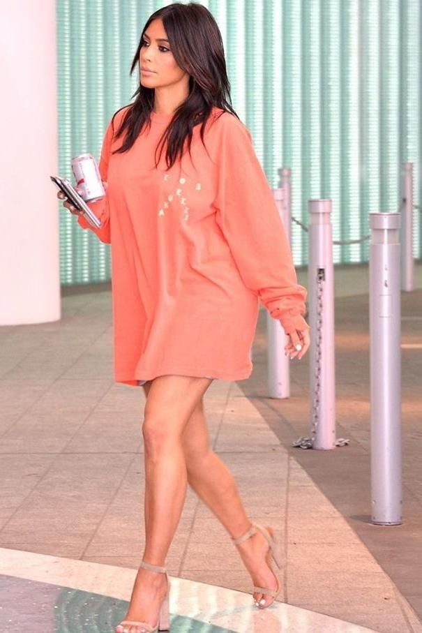 Kim Kardashian wearing Kanye Pablo Ultra Light Beams T-Shirt and Yeezy Suede Heel Sandals