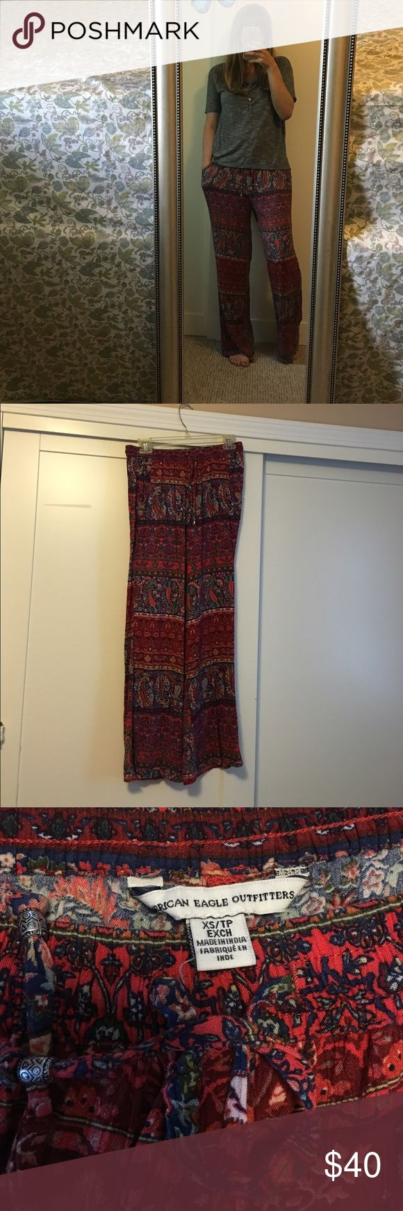 American Eagle red gypsy wide leg pants Wore these once to a Florence & the Machine concert ..... Love them... I just bought them....Prob will just sit in my closet... American Eagle Outfitters Pants Wide Leg