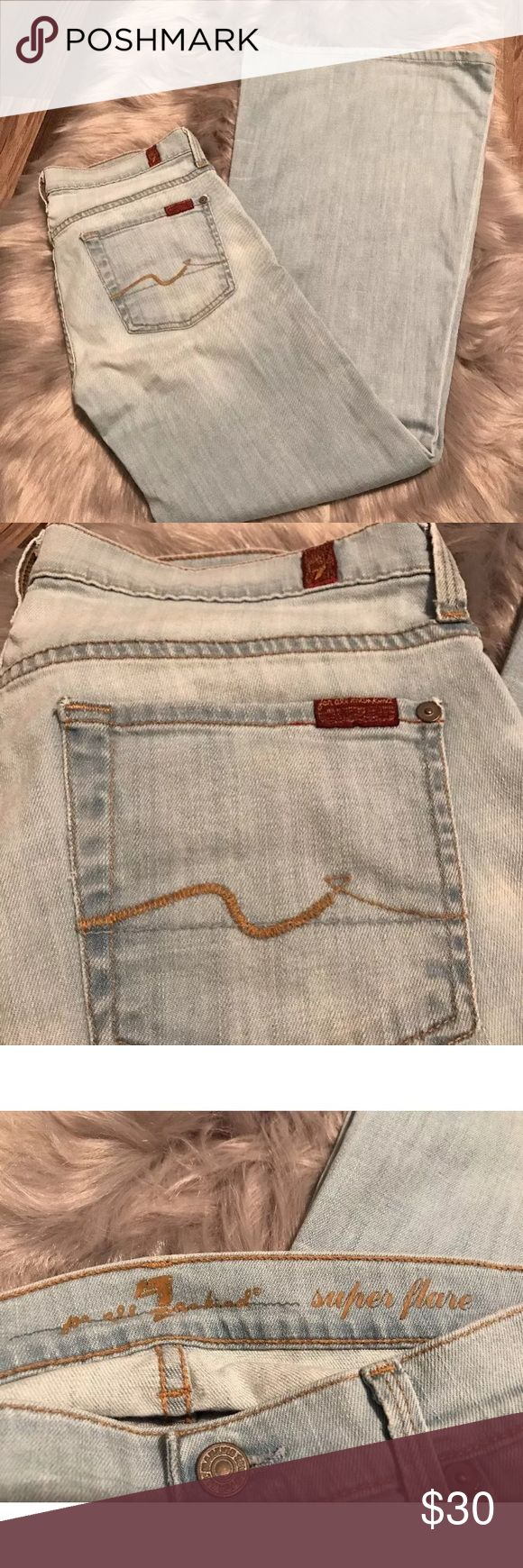 Sz 29 7 For All Mankind Super Flare Jeans Women's Size 29 7 For All Mankind super flare jeans. Light wash. Good pre-owned condition, no holes. One small spot on back pocket as pictured. Smoke & pet free. All offers welcome 7 For All Mankind Jeans Flare & Wide Leg