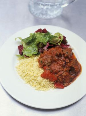 """Mediterranean Braised Lamb & Couscous.  Ingredients:  diced leg of lamb, onion, olive oil, garlic, red pepper (OK if not reactive to green pepper), tomato, basil, salt, couscous, vegetable stock (could us homemade with """"safe"""" ingredients) or just cook in water."""
