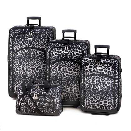 Whether you're on the move for a wild weekend abroad or a summertime safari, this four-piece luggage set will let you arrive in style with all your necessities. The set includes three rolling suitcases with retractable handles in varying sizes and a duffle with padded shoulder strap and carrying handles.