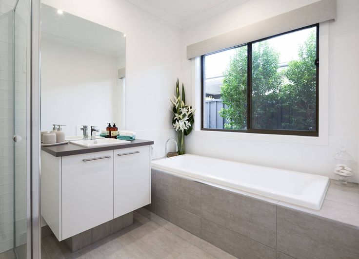 white cupboards, darker top, light floor Metricon / bathroom tiles