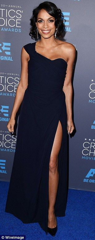 Midnight express: Rosario Dawson glided to the Critics' Choice Awards in a navy Vivienne Westwood gown with thigh-baring split