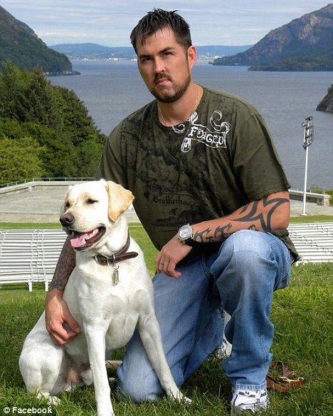 : Marcus Luttrell, pictured with his new therapy dog Rigby