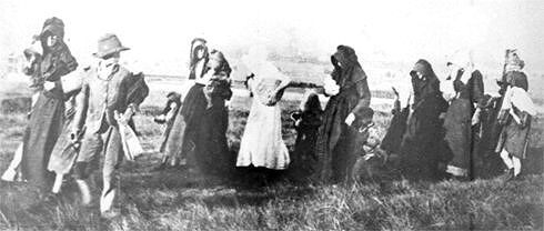 Women and children en route to concentration camp.
