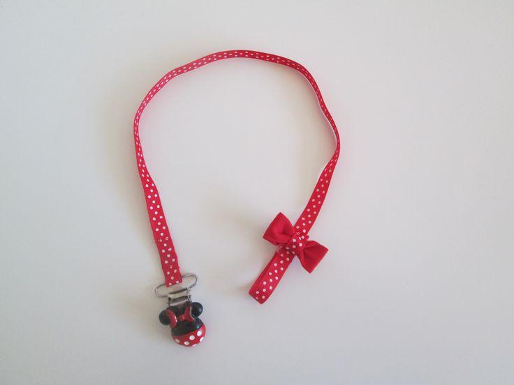 Attache tétine ruban - thème Minnie rouge a pois blanc et noeud rouge.  7.90 euros A retrouver sur ma page facebook : https://www.facebook.com/Les-Bobinettes-1699438450336617/ Ou sur ma boutique a little market : https://www.alittlemarket.com/boutique/les_bobinettes-2737221.html