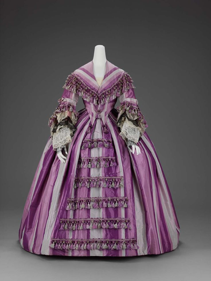 Woman's dress, about 1856–58, accession number 50.474a-b, silk plain weave ( taffeta), trimmed with silk fringe tassels, machine embroidered net, and bobbin lace, Museum of Fine Arts, Boston.