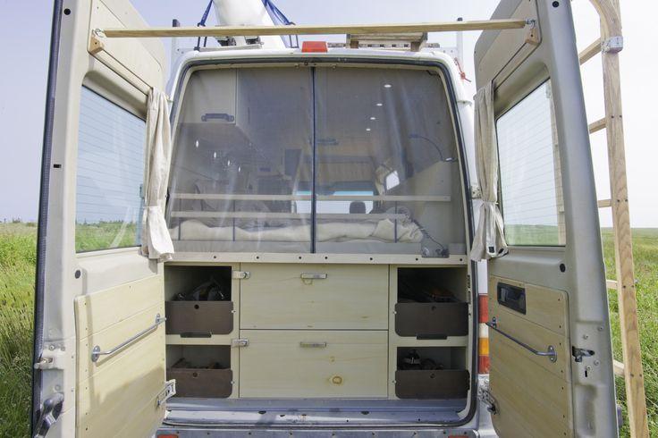 Rear-door bug screen in Peter's Sprinter conversion.