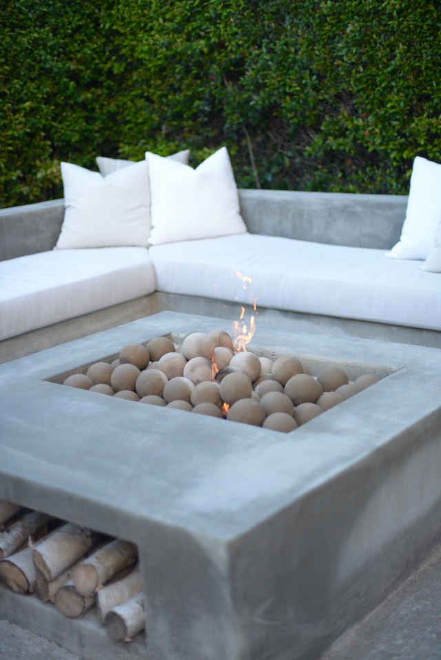 Modern cement outdoor fireplace with wood storage