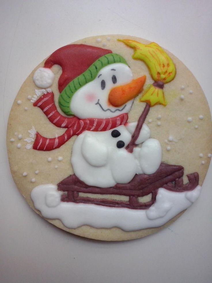 Muñeco de nieve en trineo