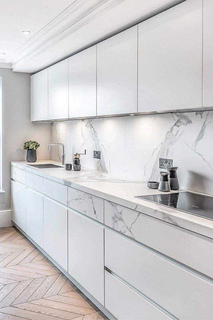 Modern White Kitchen Cabinets With Marble Countertops And Wooden Flooring