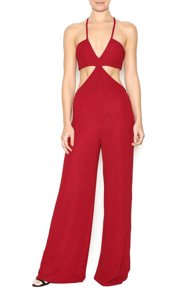 Sparkly jumpsuit with wide legs, crisscross adjustable straps, back zipper closure and side cut outs. Stand out at your next even with this stunning piece.