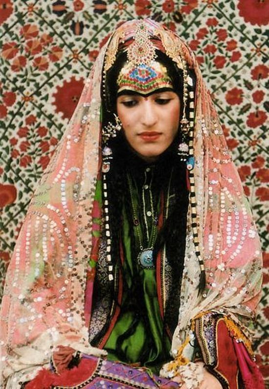 Afghan Bride | Silver jewelry with many colorful stones and clothes with a lot of heavy sequins work defines an Afghan bride the best.