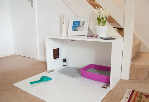 Sleek and modern cat box hides in the living room. I like the extra space to walk on a mat and remove more litter debris. I don't know if I'd want to climb on the wood each time, but maybe it'd be great anyway. | IKEA Hackers: FAKTUM kitty loo