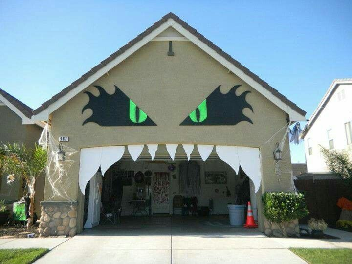 monster mayhem idea for decorating your garage door for halloween