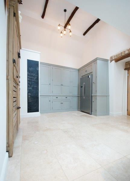 Larder cupboards in Farrow and ball lamproom grey. Ivory Travertine floor from travertine direct.