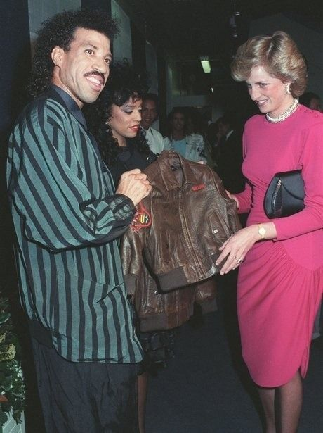 May 6, 1987: Princess Diana meets Lionel Richie and his wife Brenda who gives her two leather jackets for Prince William and Prince Harry, at Richies final Wembley concert, in London.