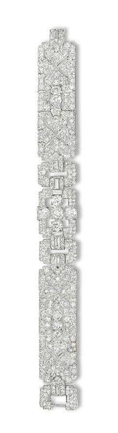 AN ART DECO DIAMOND BRACELET, BY CARTIER   Designed as two pavé-set diamond geometric panels to the central openwork buckle-link plaque set to the centre with five old-cut diamonds with baguette-cut diamond detail, circa 1930, 17.9 cm long  Signed Cartier, No. 3419429