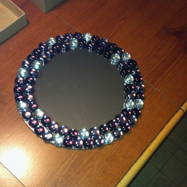 get a round or square un-framed mirror from a craft store and hot glue flat-bottomed marbles onto the edges . soo cute