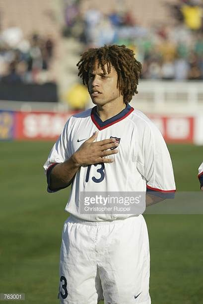 Cobi Jones of the USA stands for the National Anthem before the CONCACAF Gold Cup match against Cuba on January 21 2002 at the Rose Bowl in Pasadena...
