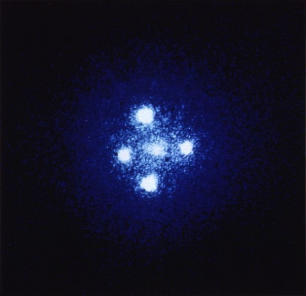 Einstein's Cross, a quasar in the Pegasus constellation, is an excellent example of gravitational lensing. The quasar is about 8 billion light-years from Earth, and sits behind a galaxy that is 400 million light-years away. Four images of the quasar appear around the galaxy because the intense gravity of the galaxy bends the light coming from the quasar.