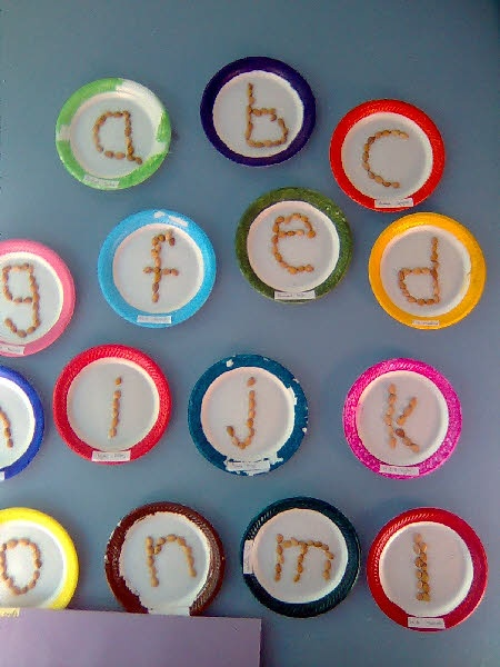 Alphabet display for the classroom using beans and paper plates