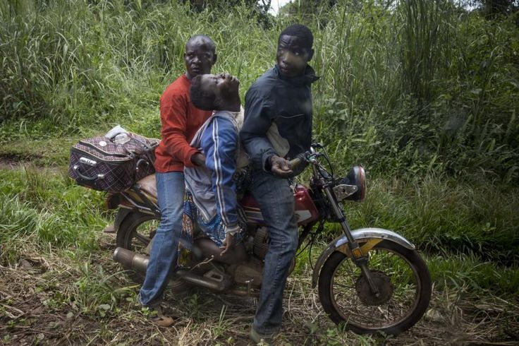 A woman suffering complications from pregnancy traveled for two hours on a motorbike from her village before a team from Doctors Without Borders took her to the hospital in Berberati, Central African Republic, Oct. 14, 2015.