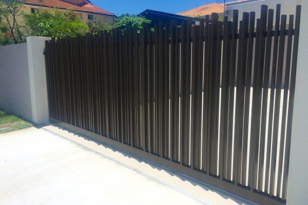 Custom black aluminium sliding gate with vertical uprights