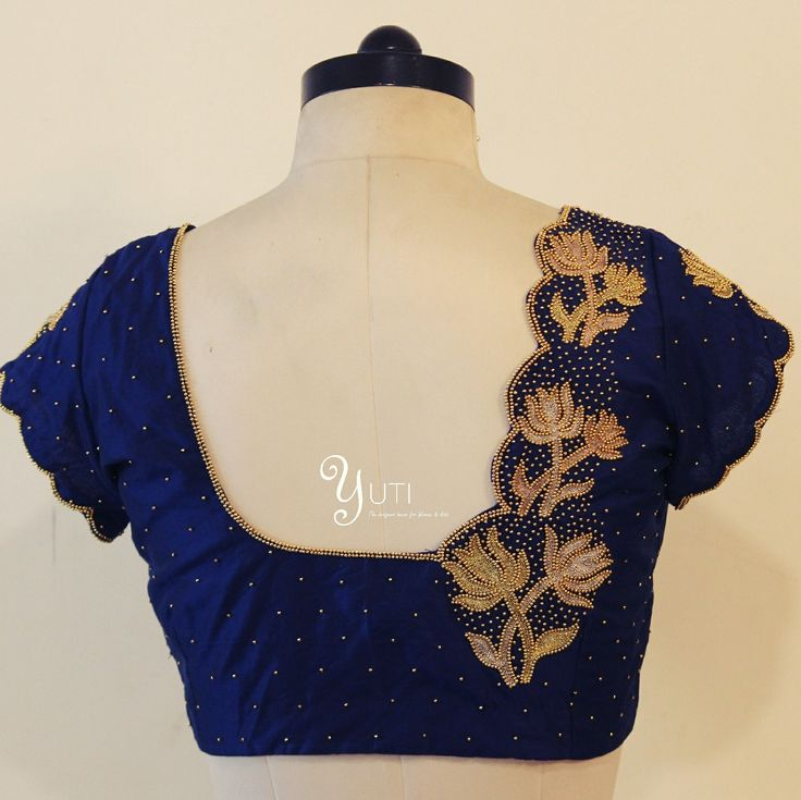 Beautiful blue color blouse with lotus eembroidery design from Yuti.   For Orders and Queries reach at 044-42179088 or whatsapp:9789903599 Address: 21 Valmiki street Thiruvanmyur Chennai 600041.