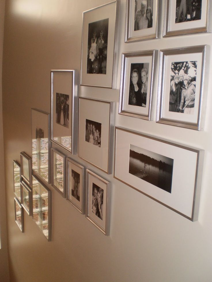 framed photos on staircase wall