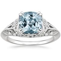 Exquisite filigree designs embellish every angle of this refined ring, creating a wonderfully delicate look that enhances the center aquamarine's natural beauty.