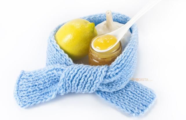 Cold remedies that are all-natural work better than any OTC drugs against a common cold, illustrated by a scarf surrounding honey, garlic and lemon. Read more on thegoodista.com