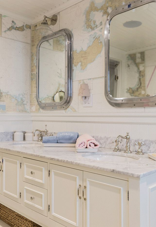 Kids Bathroom. Shared Kids Bathroom. hared kids' bathroom features vintage world map wallpaper used as a backdrop to a pair of Restoration Hardware Submarine Inset Medicine Cabinets over a white dual sink vanity topped with marble countertop fitted with his and her sinks paired with polished nickel hook and spout faucets. #SharedBathroom #KidsBathroom #Bathroom   Brookes and Hill Custom Builders.