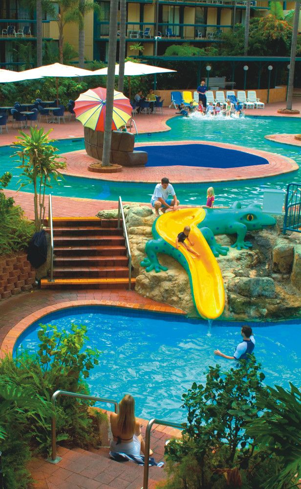 Take the waterslide between the lagoon pools!