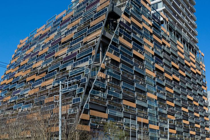 kengo kuma clads toshima ward office in tokyo with a series of panels